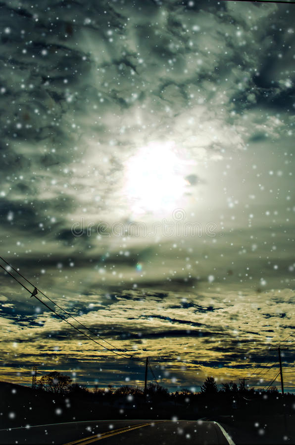 Snowy sky road. A snowy winter sky from the highway royalty free stock photos