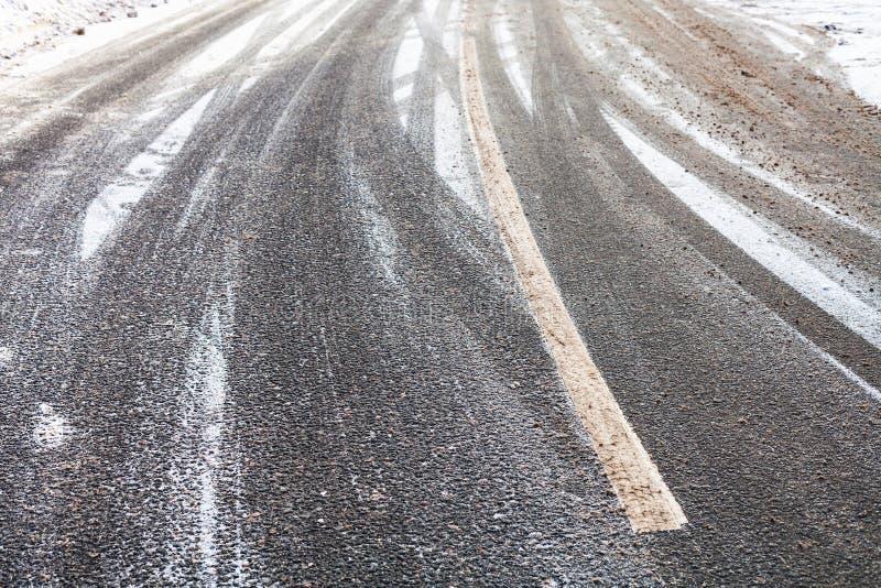 Snowy slippery road in winter. Surface of snowy slippery road in winter day stock photos