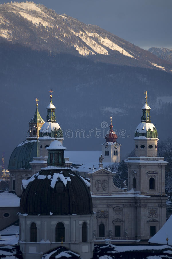 Snowy spires. Church spires covered with snow in Salzburg royalty free stock images