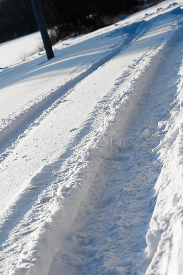 Snowy Tracks. Deep tire track in the snow stock image