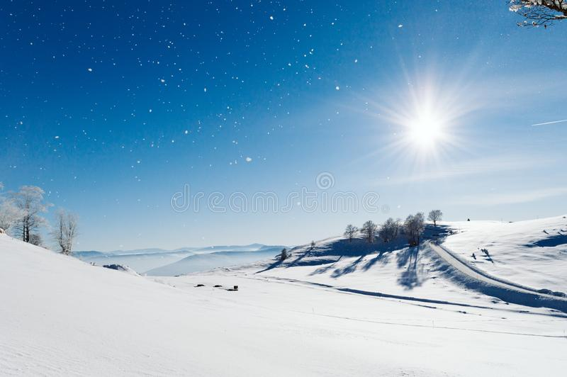 Snowy valley at the top of the mountain stock photo