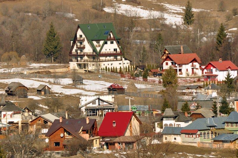 Snowy village chalet stock image