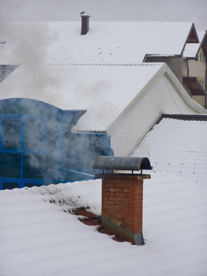 Free Snowy Village Roofs Stock Photo - 12265030