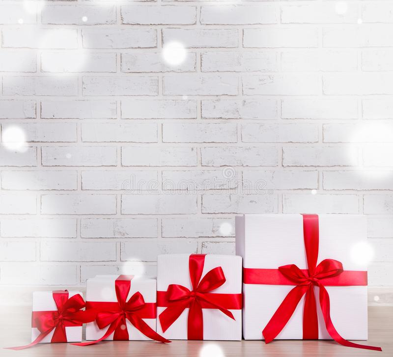 Winter and christmas background - gift boxes over brick wall stock photo