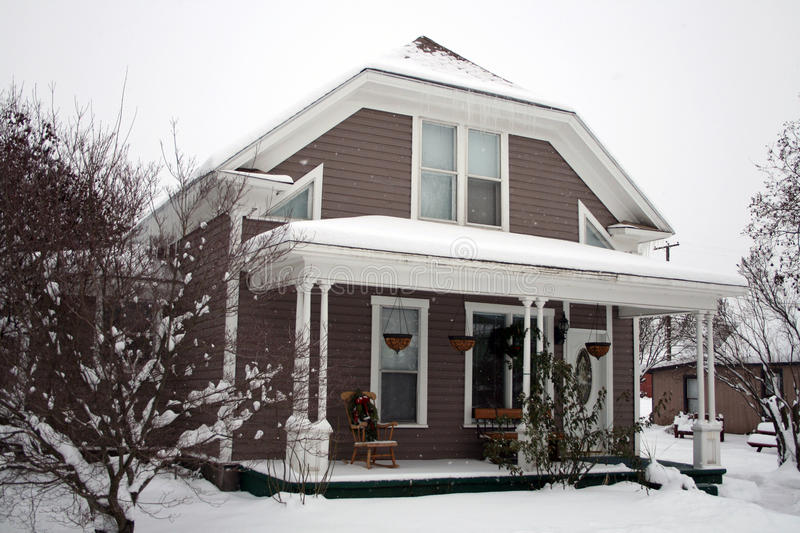 Snowy winter house royalty free stock image