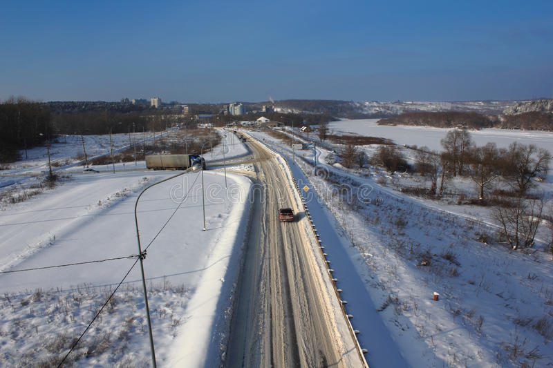 Snowy winter road top view. Snowy winter road at riverside top view stock images