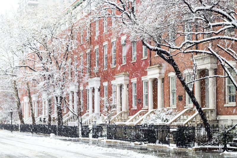 Snowy winter street scene by Washington Square Park in New York City. Snowy winter street scene with historic buildings along Washington Square Park in Manhattan stock image