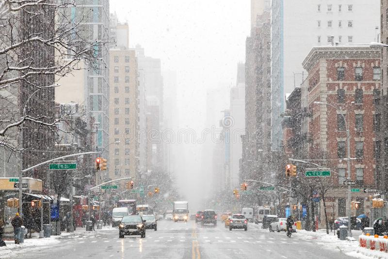 Snowy winter street scene looking down 3rd Avenue in New York City stock photography