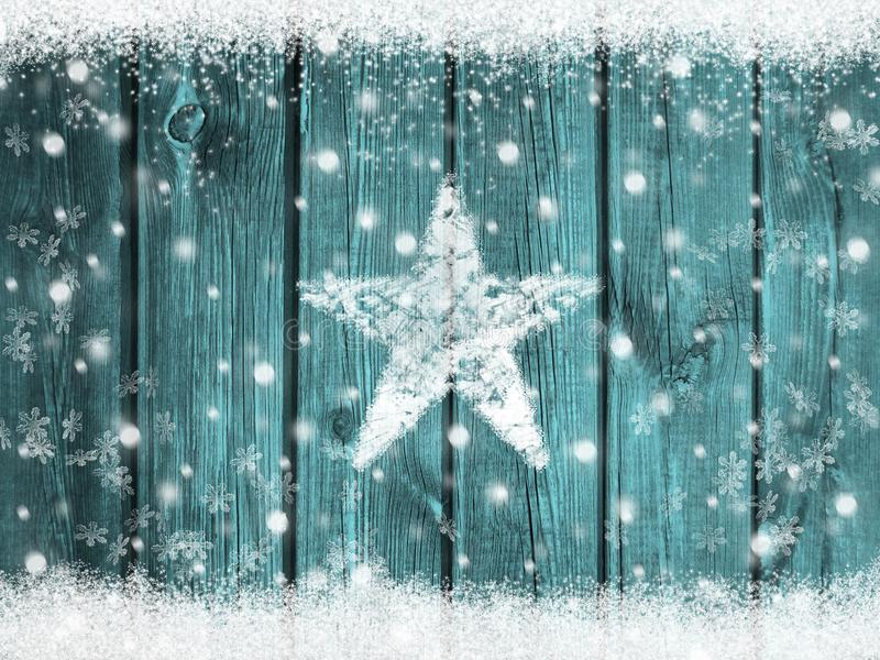 Snowy wood background with snowflakes and snow star for christmas and winter. Snowy rustic wooden background with snowflakes border and snow star for festive stock photos