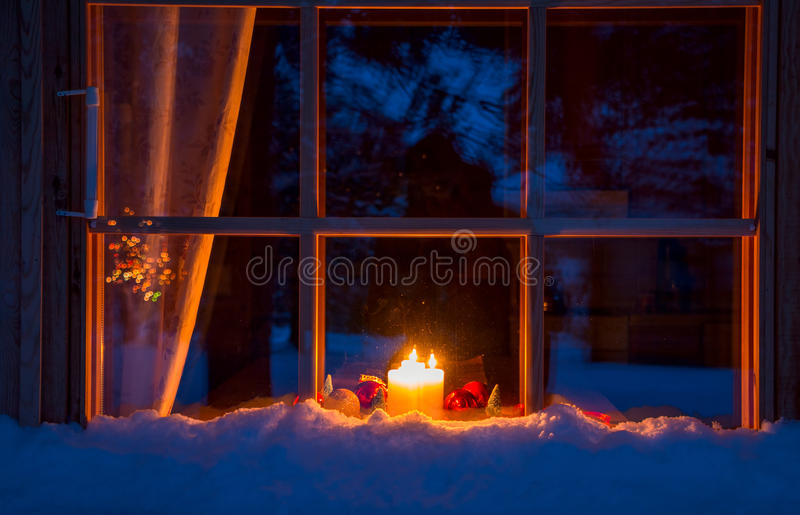 Snowy Wooden Window, Christmas Decoration and Candles stock photos