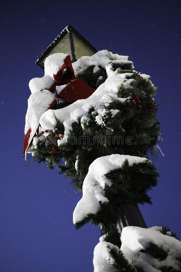 Snowy wreath on lamp post stock photos