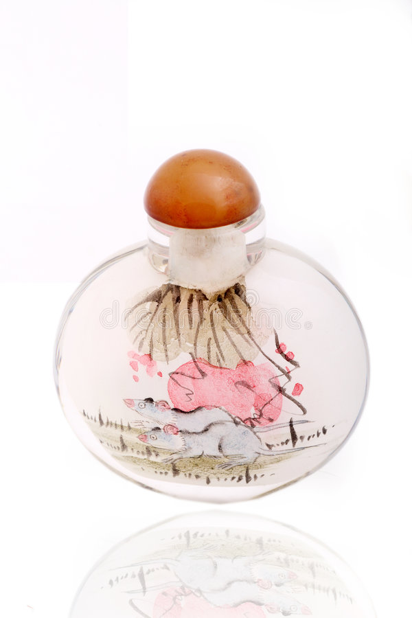 Snuff bottle. With inside painting on white.It has more than 100 years of history stock image