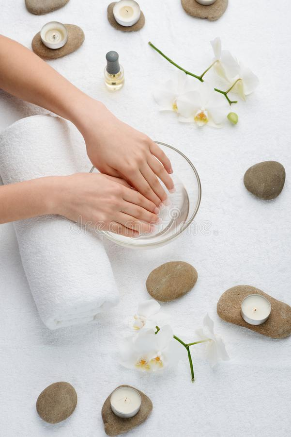 Soaking nails in warm water. Moistening cuticle before removing it. Resting and getting an elegant look for hands royalty free stock photography