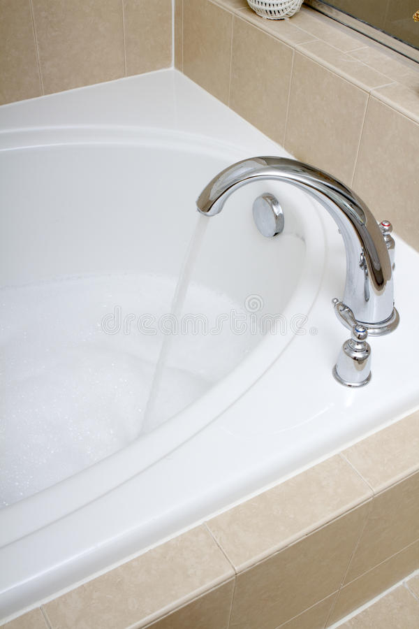 Soaking Tub Faucet stock image. Image of vertical, tile - 33019907