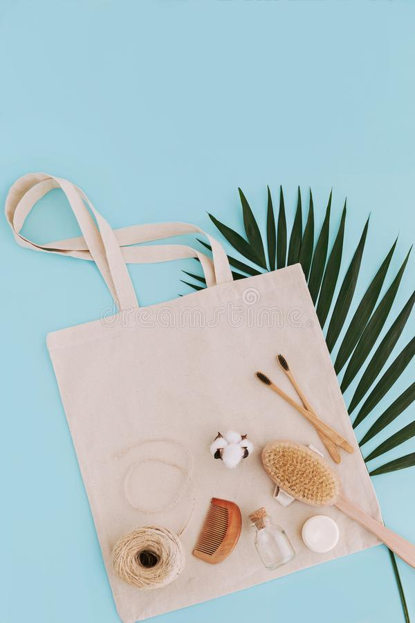 Soap, bamboo toothbrushes, natural brush, cosmetics products and tools on reusable cotton bag. Zero waste stock images