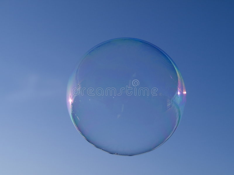 Soap bubble and blue sky royalty free stock image