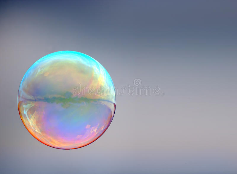 Soap bubble on gray royalty free stock images