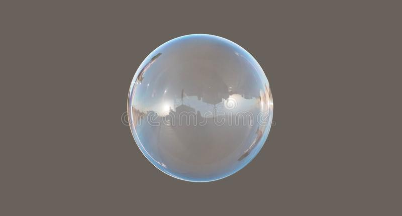 Soap bubble isolated on gray, road sun and blue sky reflection. Clear soap bubble isolated on gray background with blue sky reflection, sun on sky, building and stock photos