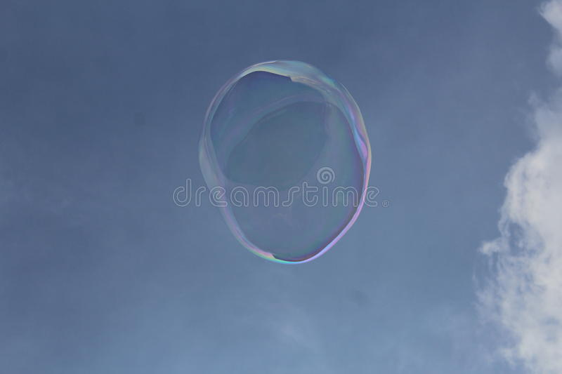 Soap bubble in the sky royalty free stock photo