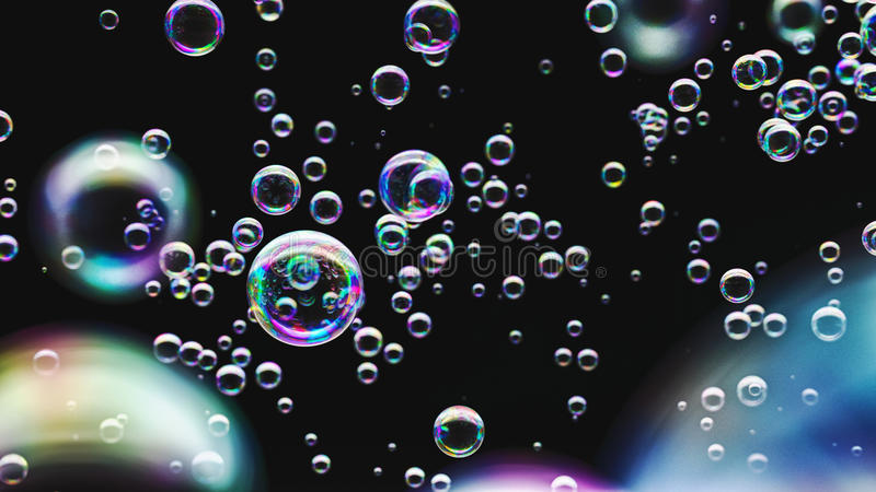 Soap Bubbles against a Minimalist Black Background royalty free stock photo