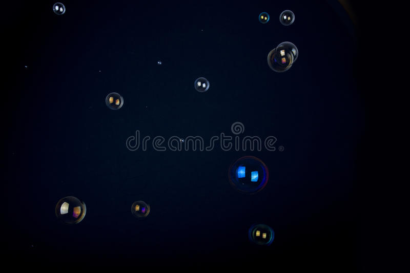 Soap bubbles on black background. Overlay of Soap bubbles photographed in front of a black background. Used for composings in blending mode multiply negatively royalty free stock image