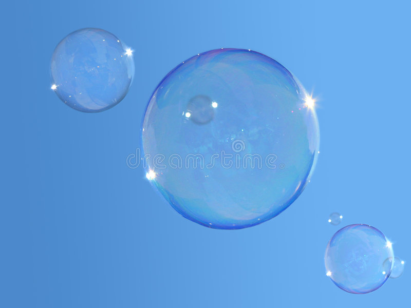 Soap-bubbles on blue sky stock image