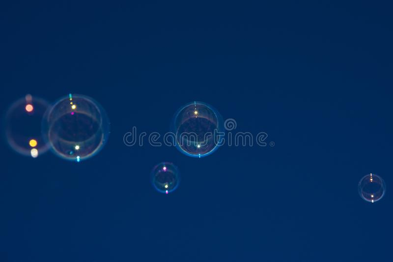 Soap bubbles in the blue sky stock photography