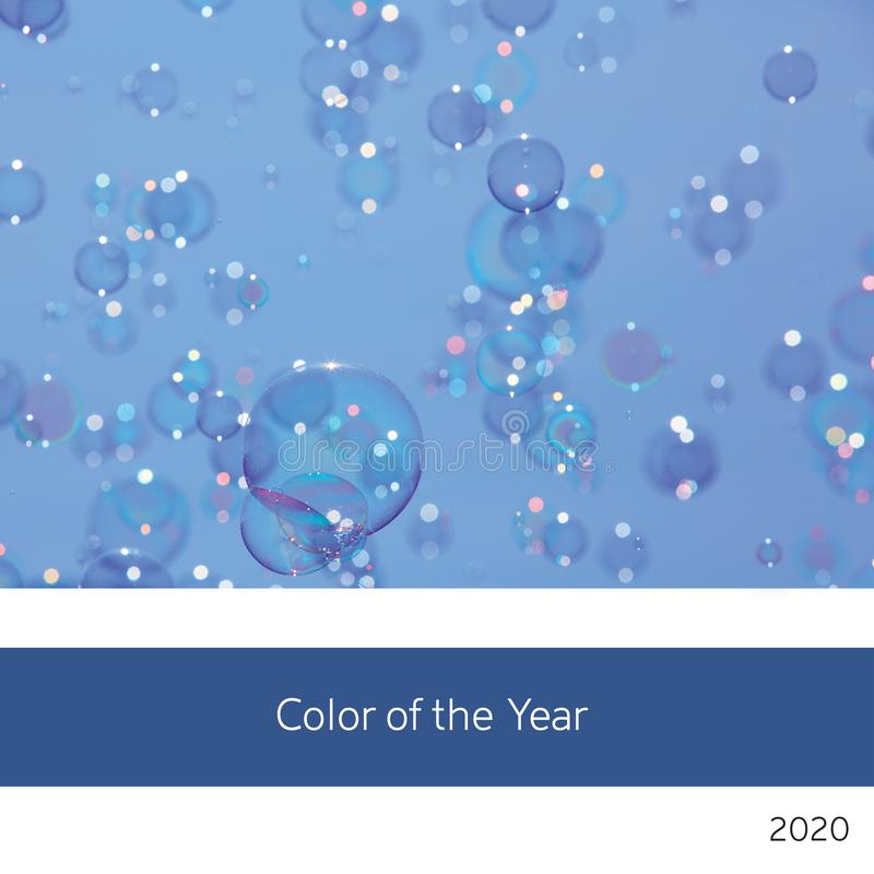Soap bubbles and blue sky colour of the year 2020 royalty free stock photography