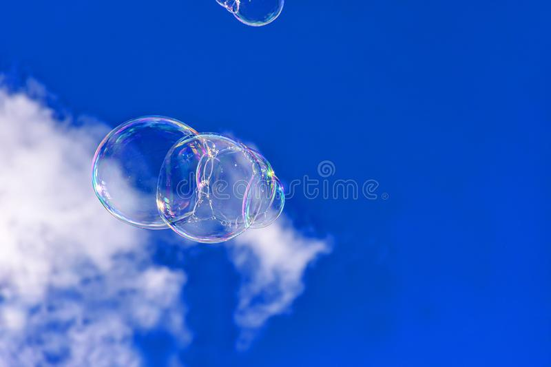 Soap bubbles in blue sky royalty free stock images