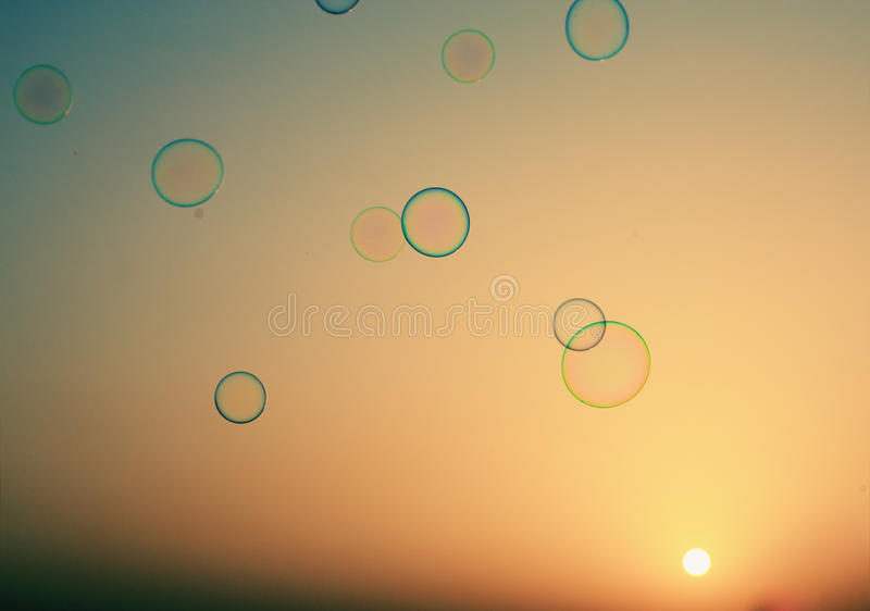 Soap bubbles floating in the air stock images
