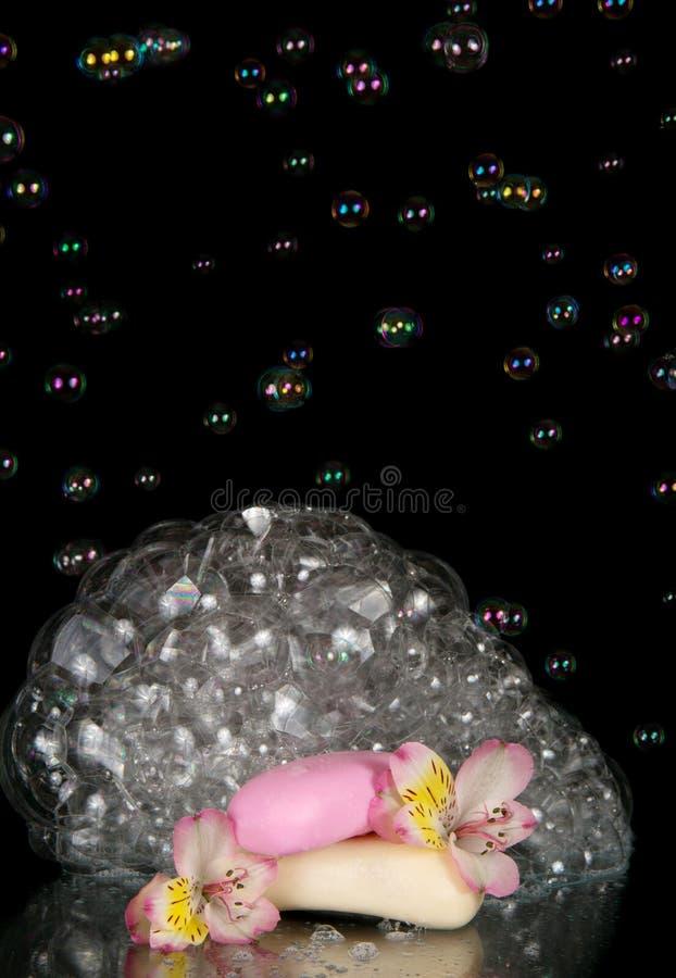 Soap bubbles, flower alstroemeria and piece stock images