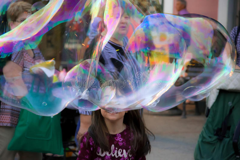 Soap bubbles and girl royalty free stock images