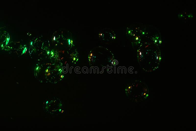 Soap bubbles isolated on a black background. Copy space.  stock photography