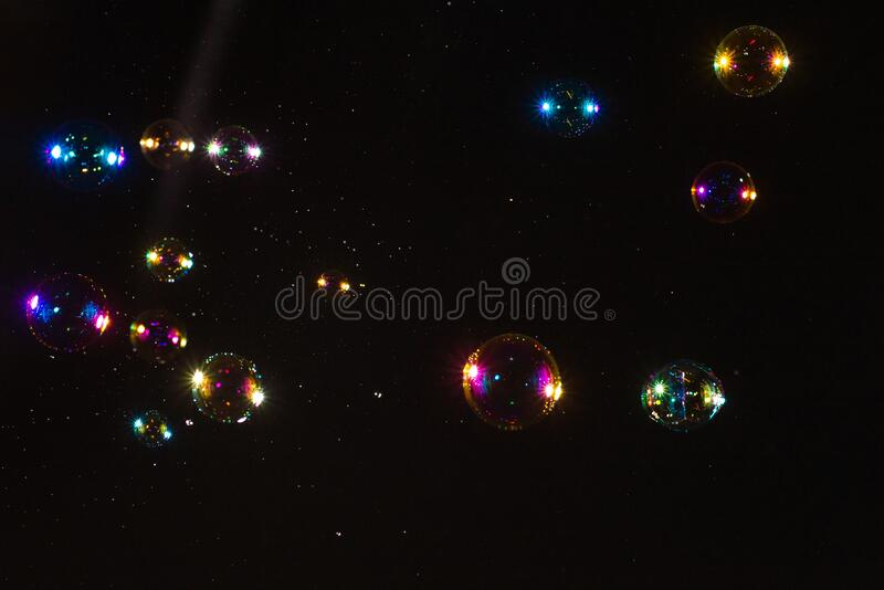 Soap bubbles isolated on a black background. Copy space.  stock photos