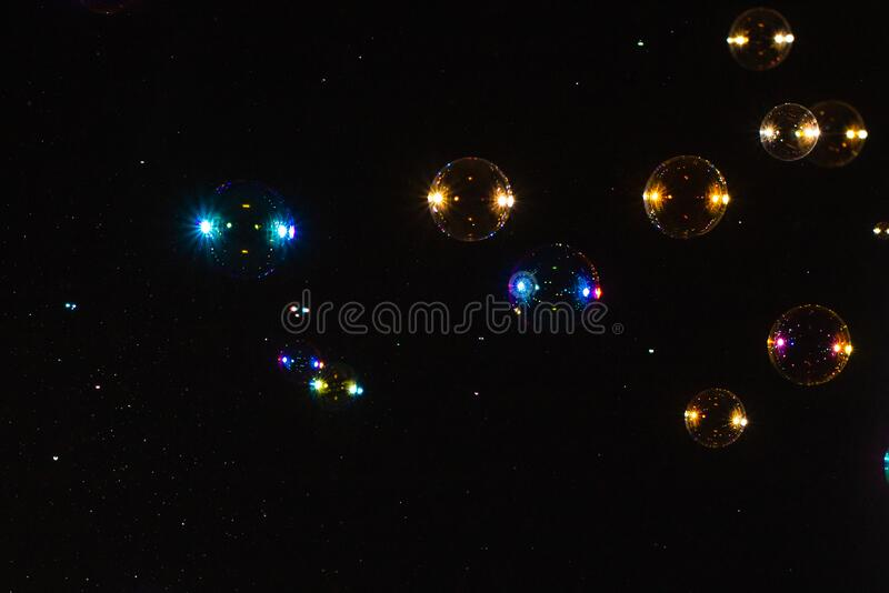 Soap bubbles isolated on a black background. Copy space. ÑŽ royalty free stock photography