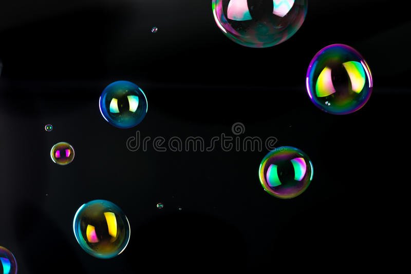 Soap bubbles isolated. Large soap bubbles isolated on black background royalty free stock photography