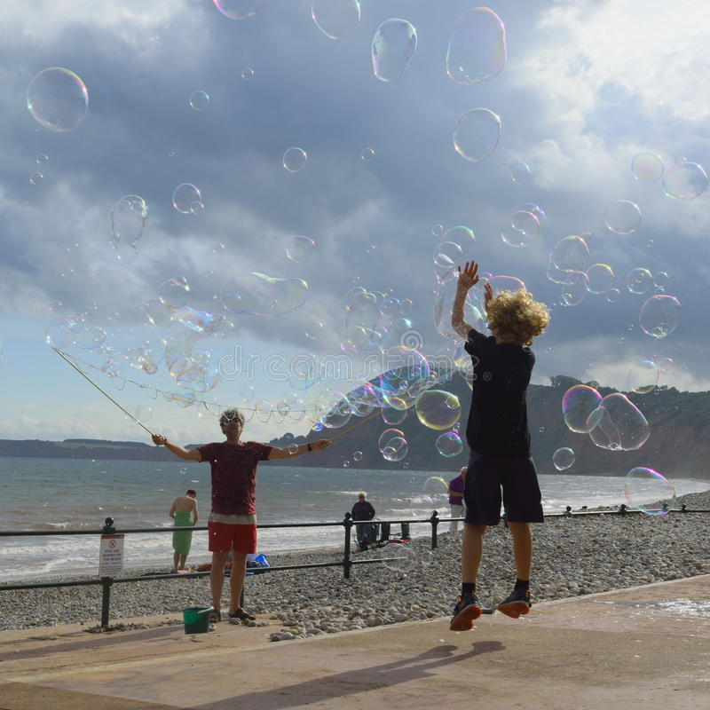 Soap bubbles. People having fun with soap bubbles on a hot summer day in Sidmouth, Devon