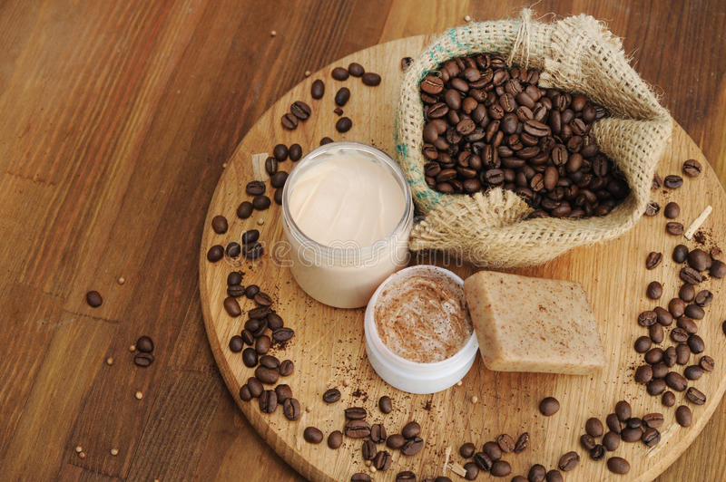 Soap, cream and scrub and coffee beans in burlap sack stock photography