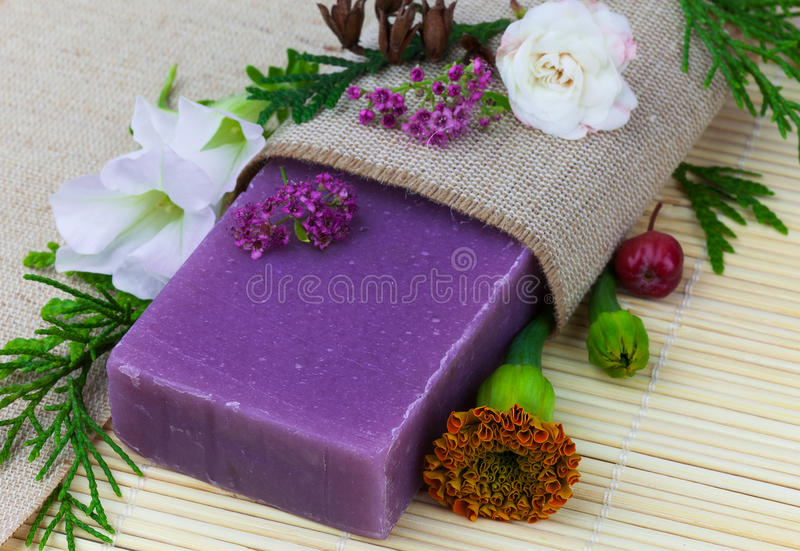 Soap with flowers. Macro view of handmade soap with flowers on the mat royalty free stock images