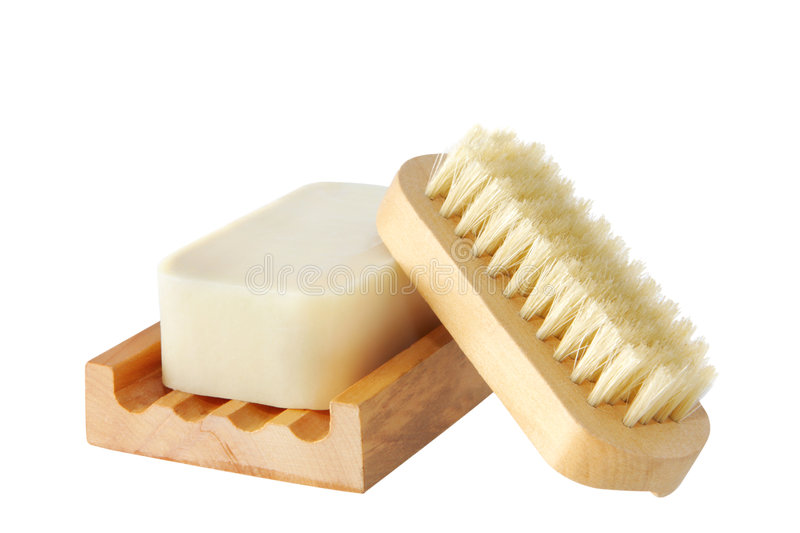 Soap and Nail Brush. Soap on a wooden soap dish, with matching nail brush. Isolated on white stock photography