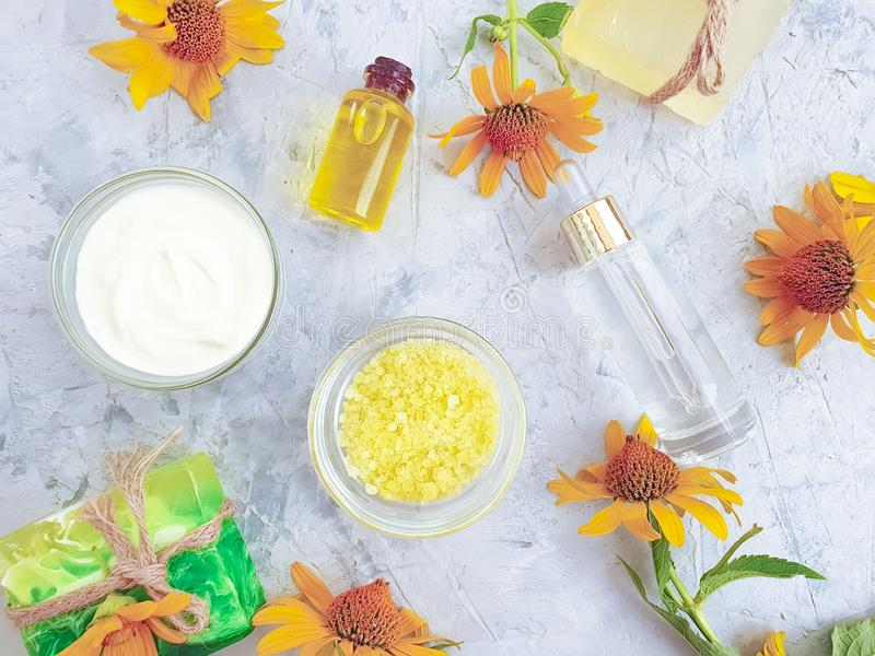 Soap, oil yellow flower homemade relaxation essential on a gray concrete background royalty free stock images