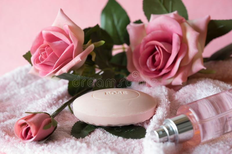 Soap and roses pink background stock photo