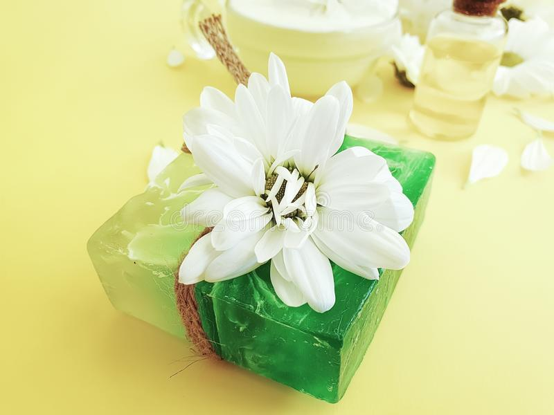 Soap, salt, oil, cosmetic cream composition accessories chrysanthemum extract organic flower background royalty free stock images