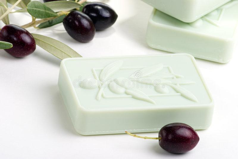 Soap spa set. Spa set - fresh black olives and organic soap over white towel. best suited for relaxing and health commercials royalty free stock photography