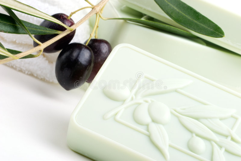 Soap spa set. Spa set - fresh black olives and organic soap over white towel. best suited for relaxing and health commercials stock photo