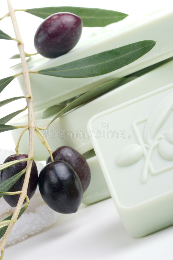 Soap spa set. Spa set - fresh black olives and organic soap over white towel. best suited for relaxing and health commercials royalty free stock photo