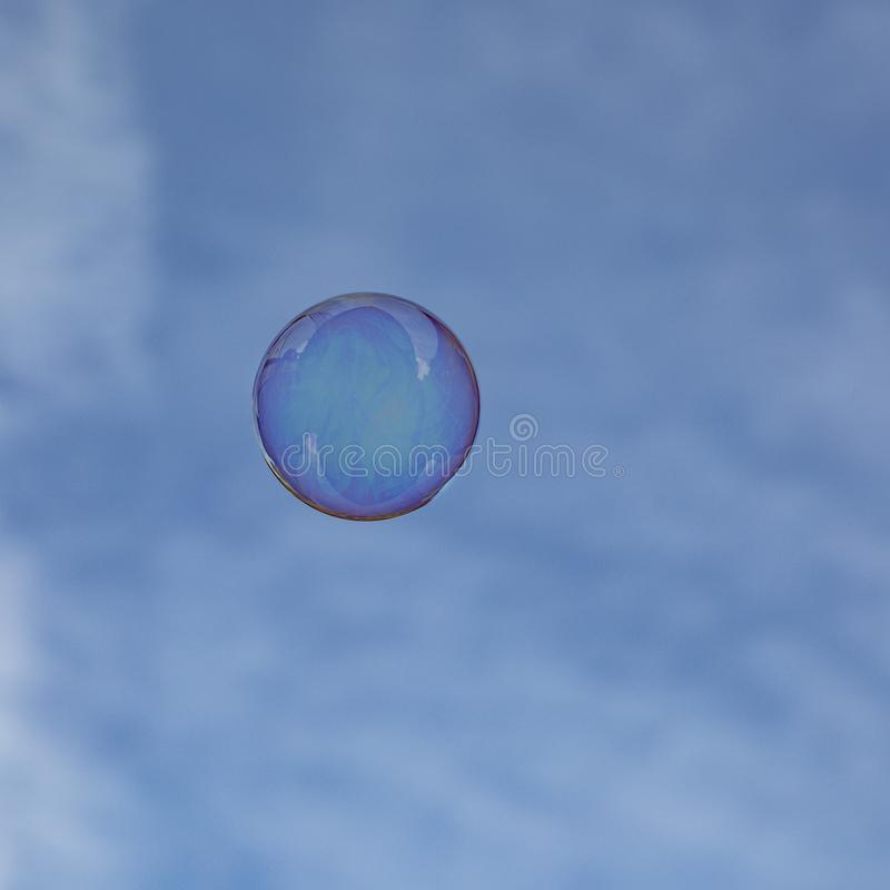 Soapbubbles flying in the sky. Soapbubbles flying in the blue sky stock images