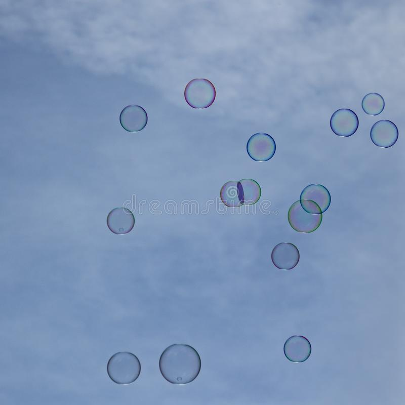 Soapbubbles flying in the sky. Soapbubbles flying in the blue sky royalty free stock images