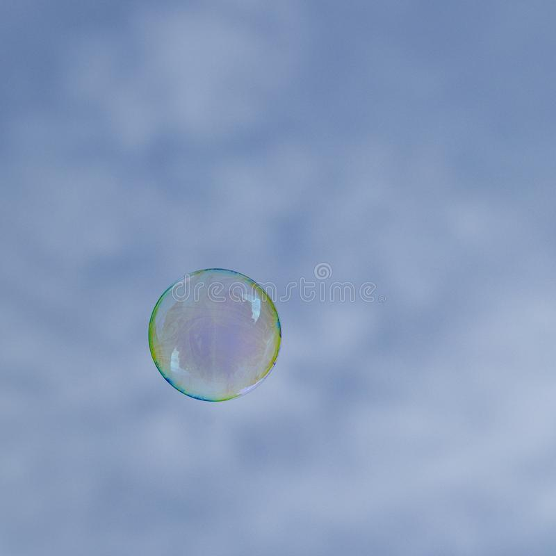 Soapbubbles flying in the sky. Soapbubbles flying in the blue sky stock photography