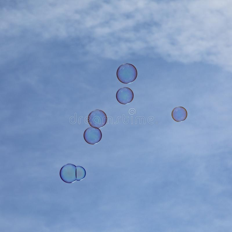 Soapbubbles flying in the sky. Soapbubbles flying in the blue sky royalty free stock photos